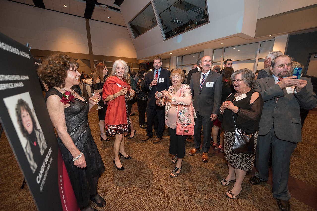 Distinguished Alumni Candy Solari (left), with guests and honorees enjoy the Distinguished Alumni Dinner on Friday, March 24, 2017 in Chico, Calif. (Jason Halley/University Photographer)