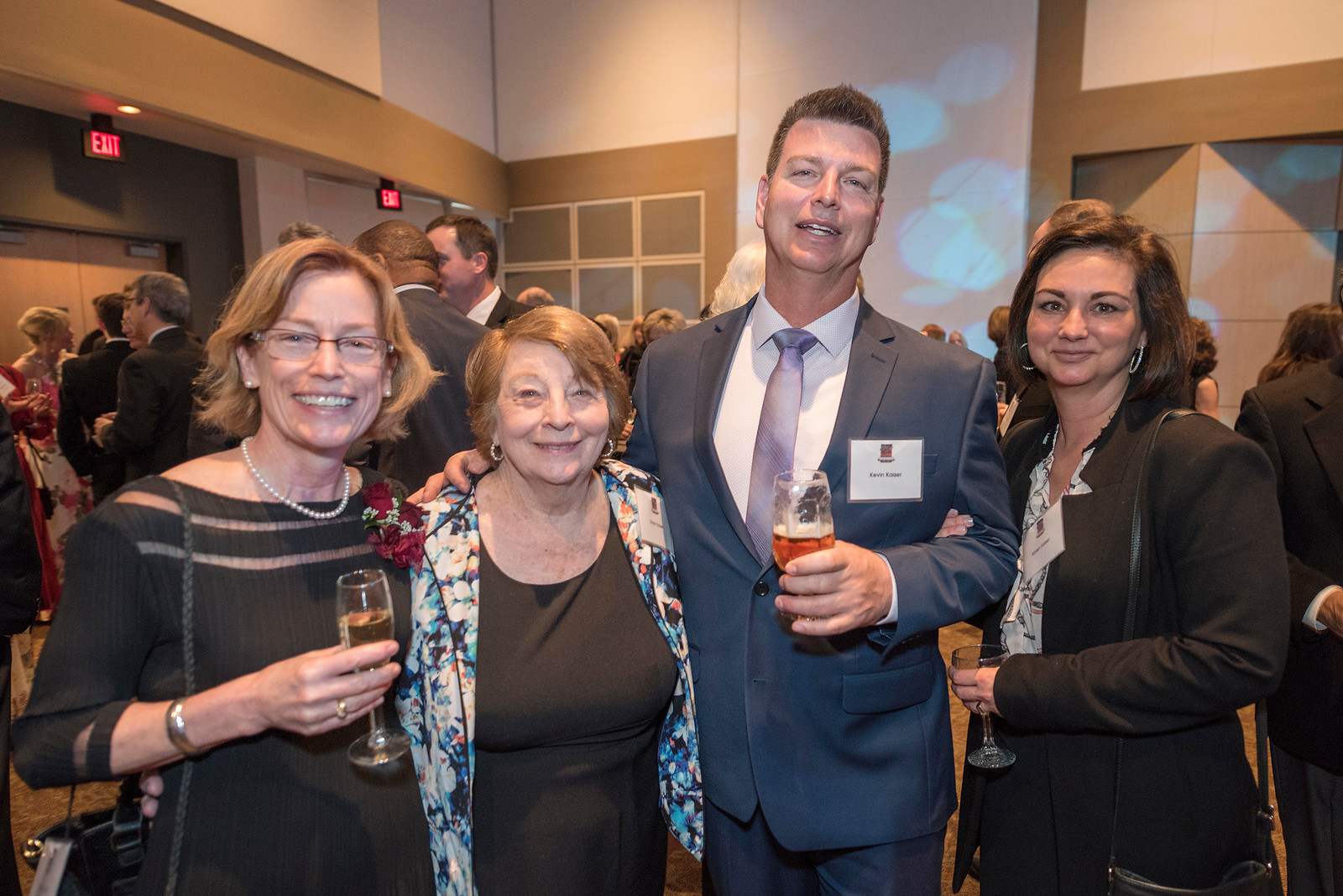 Distinguished Alumni Jenelle Ball (left), guests and honorees enjoy the Distinguished Alumni Dinner on Friday, March 24, 2017 in Chico, Calif. (Jason Halley/University Photographer)