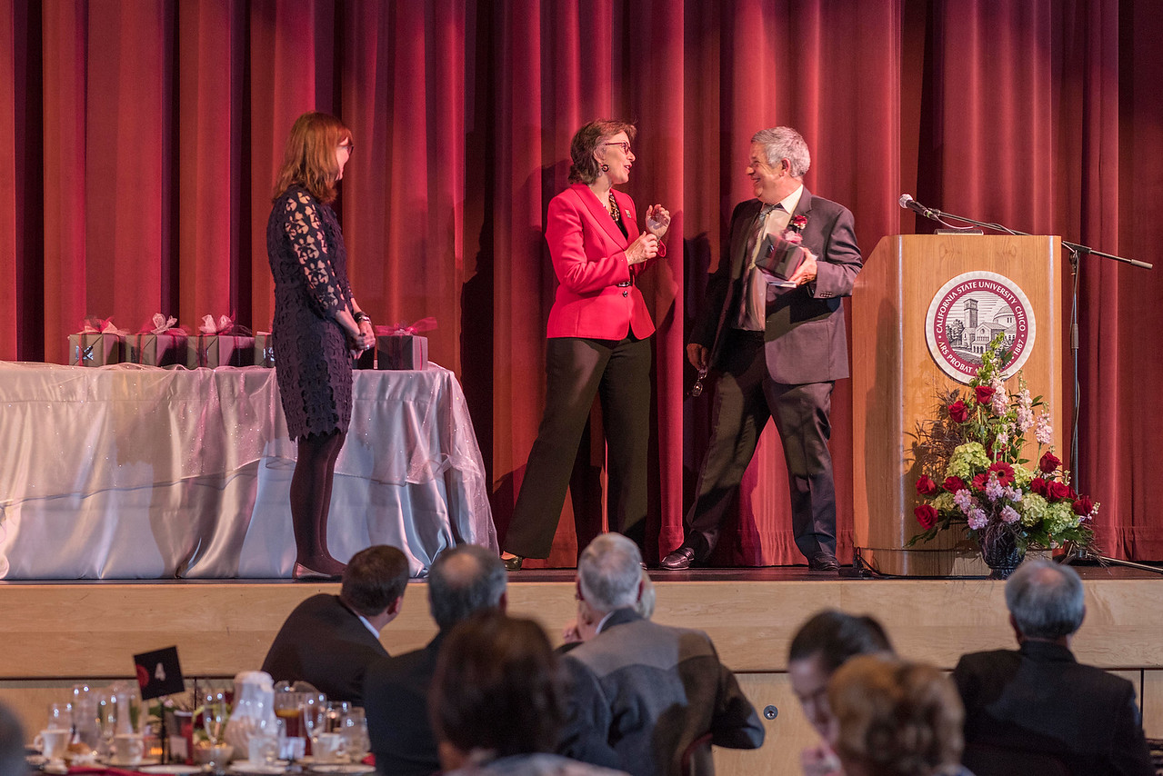Sue Anderson (left), President Gayle Hutchinson (center) thanks Distinguished Alumni Jose Manuel Leal da Costa (right) talks to guests and honorees during the Distinguished Alumni Dinner on Friday, March 24, 2017 in Chico, Calif. (Jason Halley/University Photographer)