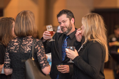 Mark Mavis (center), guests and honorees enjoy the Distinguished Alumni Dinner on Friday, March 24, 2017 in Chico, Calif. (Jason Halley/University Photographer)