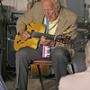 Brian Sapp | The Goshen News<br /> Bucky Pizzarelli plays his guitar at the Elkhart Jazz Festival.