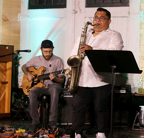 LYNNE ZEHR  THE GOSHEN NEWS<br /> After Ours, featuring Sam Que, performs at the Elkhart Jazz Festival.