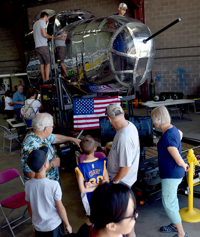 . People gather around the B-25 Mitchell Bomber replica built by the Young Aviators of the Experimental Aircraft Association, Mile High Chapter 43. The Erie Air Fair was held at Erie Municipal Airport on Saturday.  For more photos, go to dailycamera.com.  Cliff Grassmick  Staff Photographer August 12, 2017
