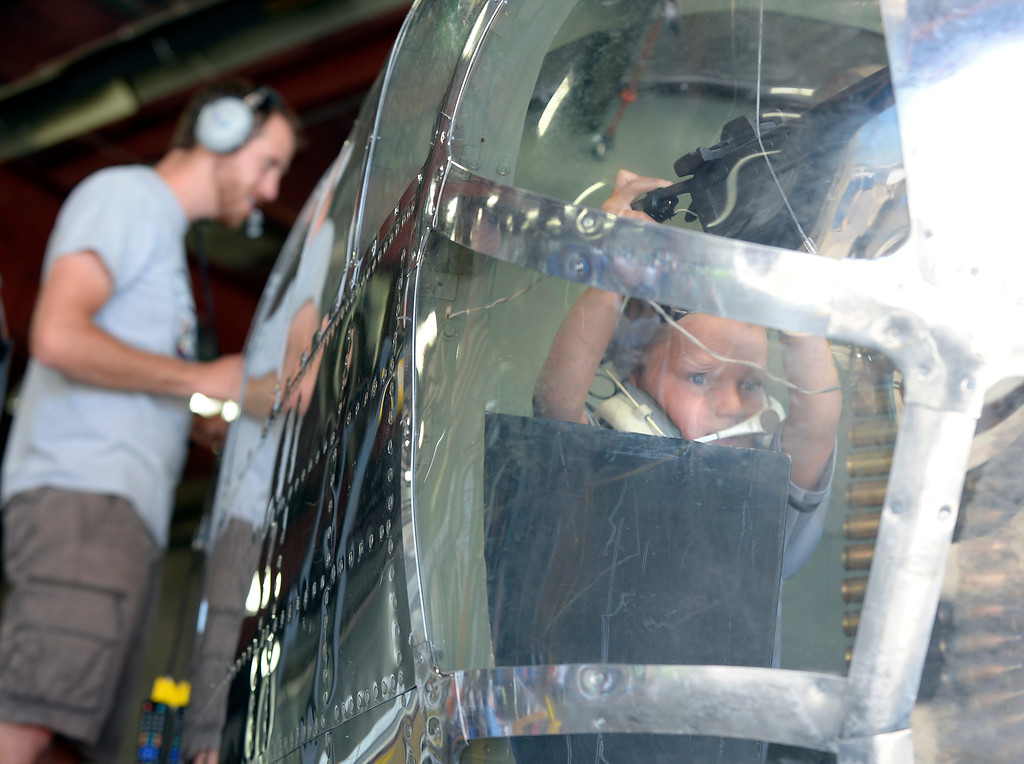 . Blake Lucido, 7, tries out the front gunner position in the B-25 Mitchell Bomber replica built by the Young Aviators of the Experimental Aircraft Association, Mile High Chapter 43. The Erie Air Fair was held at Erie Municipal Airport on Saturday.  For more photos, go to dailycamera.com.  Cliff Grassmick  Staff Photographer August 12, 2017