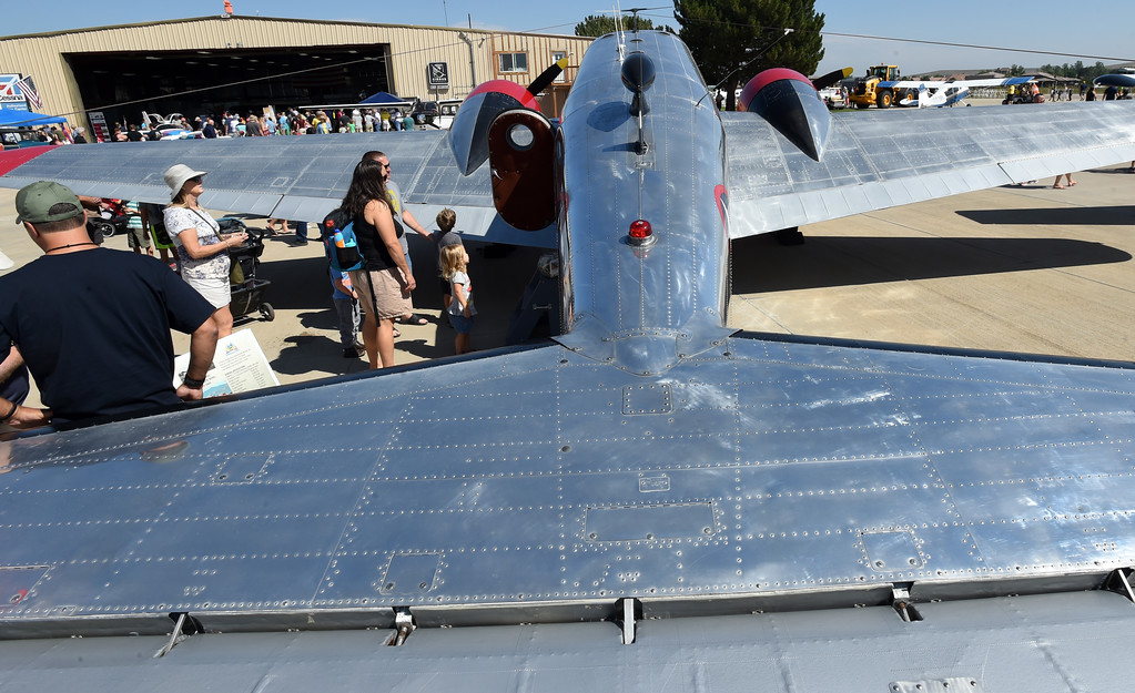 . Aviation fans wait in line to see inside the 1943 US Navy SNB-5 at the air fair in Erie. The Erie Air Fair was held at Erie Municipal Airport on Saturday.  For more photos, go to dailycamera.com.  Cliff Grassmick  Staff Photographer August 12, 2017
