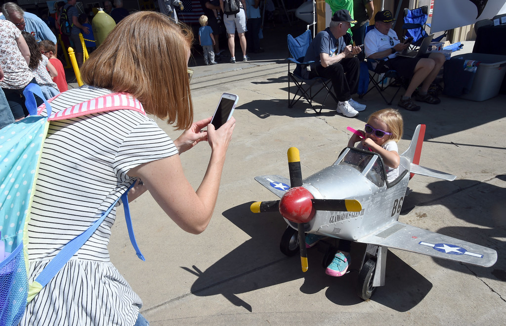 . Emily Jamison photographs her daughter, Emma, inside a mini plane at the air fair. The Erie Air Fair was held at Erie Municipal Airport on Saturday.  For more photos, go to dailycamera.com.  Cliff Grassmick  Staff Photographer August 12, 2017