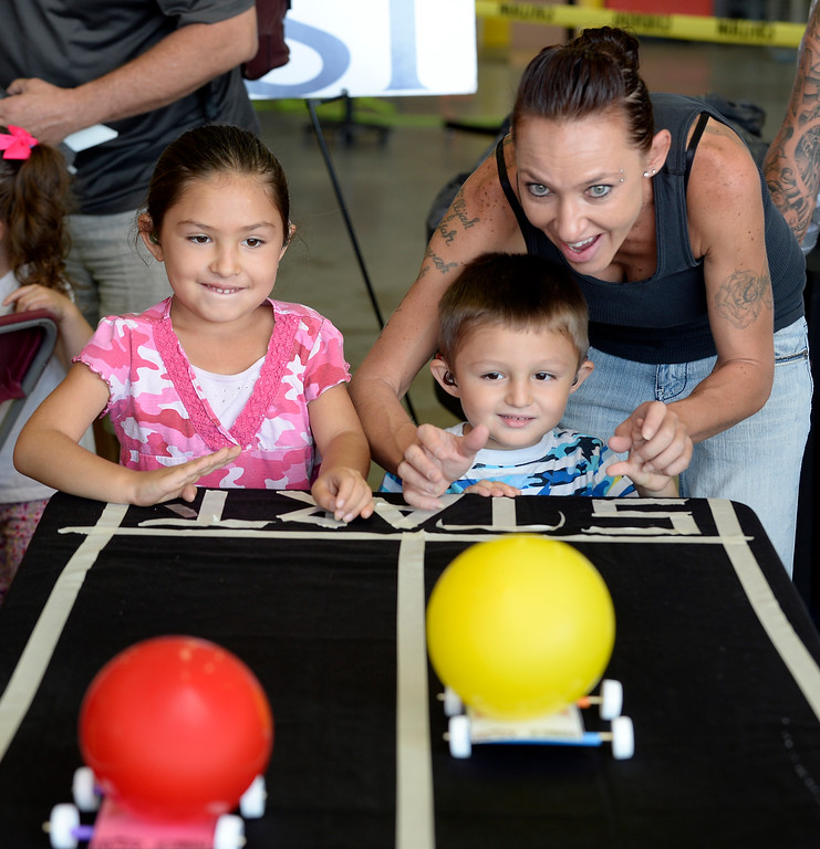 . Maryah Weber, left, and her brother, Maziah, along with mother, Brittany, use air power to propel racers at the air fair. The Erie Air Fair was held at Erie Municipal Airport on Saturday.  For more photos, go to dailycamera.com.  Cliff Grassmick  Staff Photographer August 12, 2017