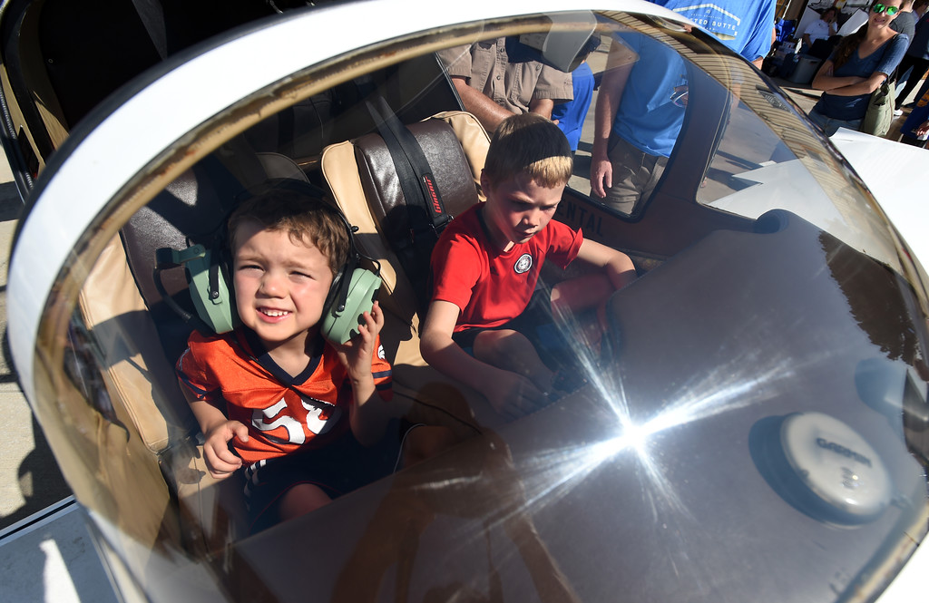 . Harper Wilkin, 5, left, and his brother, Dean, 7, get to check out a real plane at the air fair. The Erie Air Fair was held at Erie Municipal Airport on Saturday.  For more photos, go to dailycamera.com.  Cliff Grassmick  Staff Photographer August 12, 2017