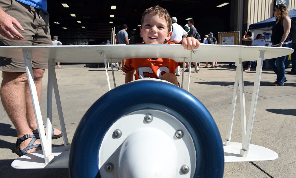 . Harper Wilkin, 5,  takes spin in a mini biplane at the air fair in Erie. The Erie Air Fair was held at Erie Municipal Airport on Saturday.  For more photos, go to dailycamera.com.  Cliff Grassmick  Staff Photographer August 12, 2017