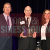 Vince Saroni, center accepts CP&Y's award for being the No. 38 Middle Market 50 company from Jim LaFontaine, left, and Jessica Ranger of UMB Commercial Banking.