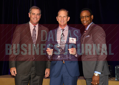 James Polfreman center accepts Solis Mamography's award for being the No. 19 Middle Market 50 company from Vance McCollough, left, and Chris Mitchell, Crowe Horwath  Partners.