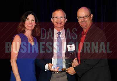 Daryl Doise, center accepts Oceans Healthcare's award for being the No. 43 Middle Market 50 company from Melanie Shaffer, left, and Brett lawson of The CFO Suite.