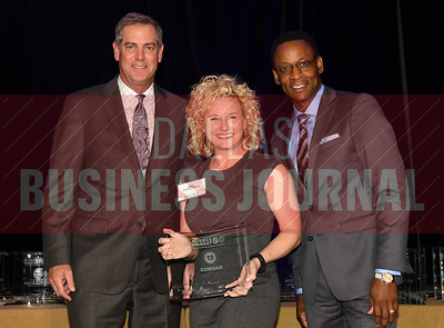 Jill Ibison Vessels center accepts Corgan's award for being the No. 13 Middle Market 50 company from Vance McCollough, left, and Chris Mitchell, Crowe Horwath  Partners.