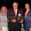 Keller Webster, center accepts KWA Construction's award for being the No. 28 Middle Market 50 company from Gemma Descoteaux, left, and Steve Fox of Polsinelli.