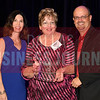 Sandra Brown, center accepts Venus Construction's award for being the No. 45 Middle Market 50 company from Melanie Shaffer, left, and Brett lawson of The CFO Suite.