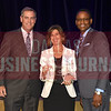 Peggy Quinn, center accepts Ivie and Associates award for being the No. 20th Middle Market 50 company from Vance McCollough, left, and Chris Mitchell, Crowe Horwath  Partners.