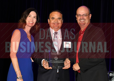 Frank Gonzalez center accepts TSP (Technology Service Professionals) award for being the No. 47 Middle Market 50 company from Melanie Shaffer, left, and Brett lawson of The CFO Suite.