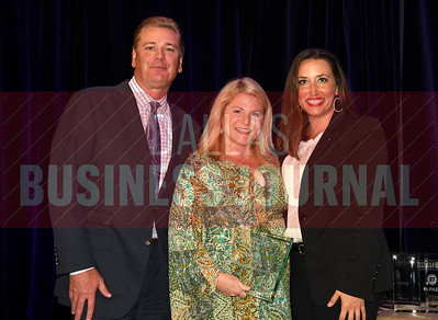 Shaddock Homes picked up the No. 32 Middle Market 50 company award from Jim LaFontaine, left, and Jessica Ranger of UMB Commercial Banking.