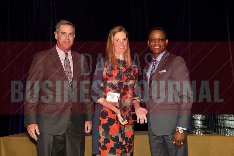 Julie Owen, center accepts Dunhill's award for being the No. 16 Middle Market 50 company from Vance McCollough, left, and Chris Mitchell, Crowe Horwath  Partners.