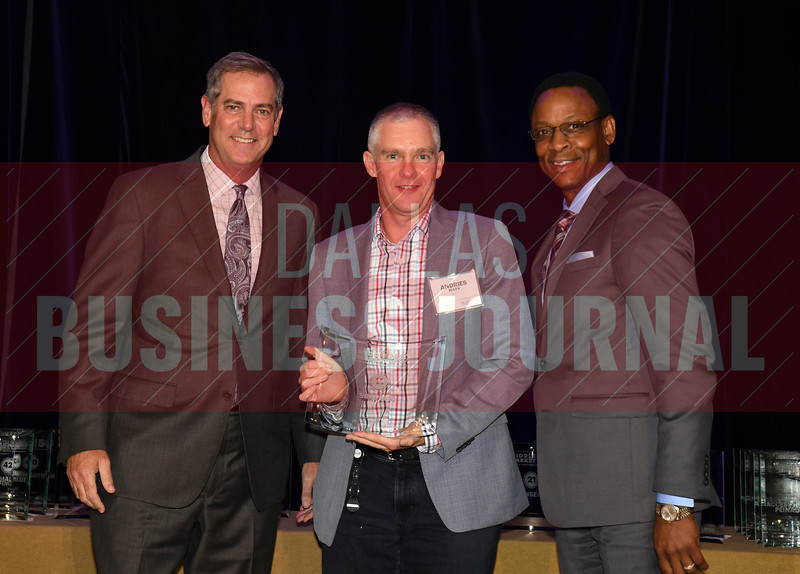 Andries Marx, center accepts Simpli.fi's award for being the No. 11 Middle Market 50 company from Vance McCollough, left, and Chris Mitchell, Crowe Horwath  Partners.