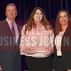 Amanda Edwards Fulgium, center accepts EST Group's award for being tied for the No. 33 Middle Market 50 company from Jim LaFontaine, left, and Jessica Ranger of UMB Commercial Banking.