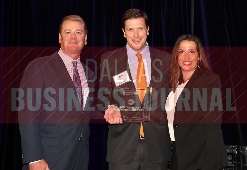 David Iliff, center accepts Southern Dock Products/Duraserv's award for being the No. 36 Middle Market 50 company from Jim LaFontaine, left, and Jessica Ranger of UMB Commercial Banking.