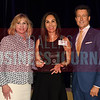 Theresa Rief, center accepts Akorbi's award for being the No. 27 Middle Market 50 company from Gemma Descoteaux, left, and Steve Fox of Polsinelli.