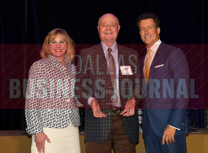 Allen Baker, center accepts BG Staffing's award for being the No. 22 Middle Market 50 company from Gemma Descoteaux, left, and Steve Fox of Polsinelli.