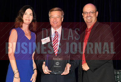 Jim Trester, center accepts Ryan LLC's award for being the No. 48 Middle Market 50 company from Melanie Shaffer, left, and Brett lawson of The CFO Suite.