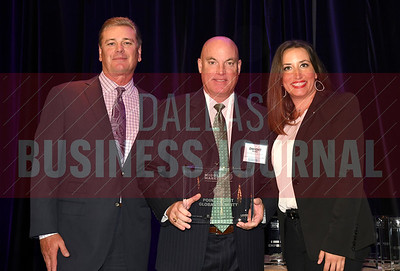 Dwight Point, center accepts P2P Global Security Inc's award for being the No. 35 Middle Market 50 company from Jim LaFontaine, left, and Jessica Ranger of UMB Commercial Banking.