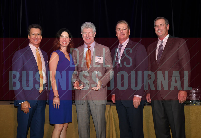 Kevin Hanigan of Legacy Texas, accepts the award for being the No. 4 Middle Market 50 company from (left to right) Steve Fox of Polsinelli; Melanie Shaffer from The CFO Suite; Jim LaFontaine of UMB Commercial Banking and Vance McCollough with Crowe Horwath.