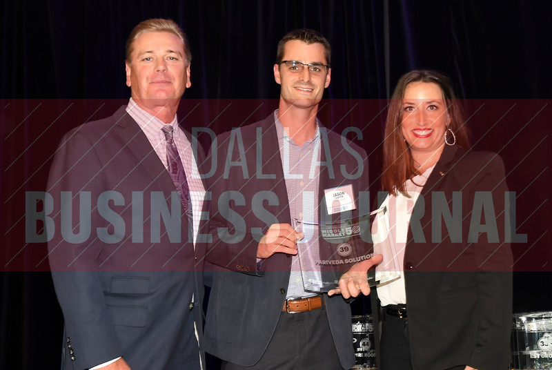 Jason Carter, center accepts Pariveda Solution's award for being the No. 39 Middle Market 50 company from Jim LaFontaine, left, and Jessica Ranger of UMB Commercial Banking.