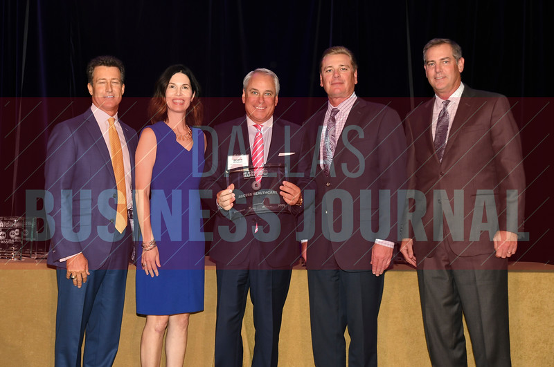 Scott Schrader of Access Healthcare Services, accepts the award for being the No. 8 Middle Market 50 company from (left to right) Steve Fox of Polsinelli; Melanie Shaffer from The CFO Suite; Jim LaFontaine of UMB Commercial Banking and Vance McCollough with Crowe Horwath.