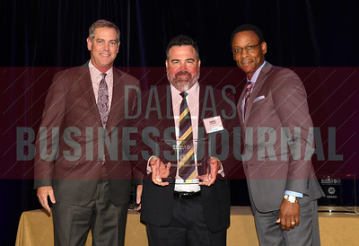 Greg Gordon, center accepts Gordon Highlander's award for being the No. 18 Middle Market 50 company from Vance McCollough, left, and Chris Mitchell, Crowe Horwath  Partners.