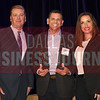Curt Rogers, center accepts Texas Airsystem's award for being tied for the No. 30 Middle Market 50 company from Jim LaFontaine, left, and Jessica Ranger of UMB Commercial Banking.