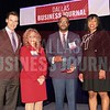 Will McClay, Assistant director of Player Personnel, Dallas Cowboys Football Club, (center) receives his Minority Business leader Award, from Christopher Trowbridge and Tammy Wood, (left), and Sonja McGill, (right) partners with sponsor Bell Nunnally.