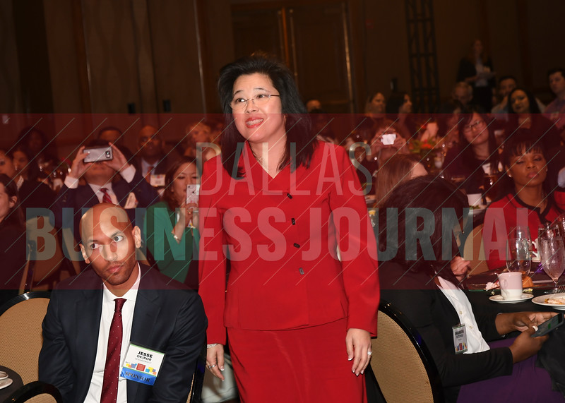 Lisa M. Ong, Director, Office of Diversity and Inclusion, PwC makes her way to the stage to accept her Minority Business Leader Award.