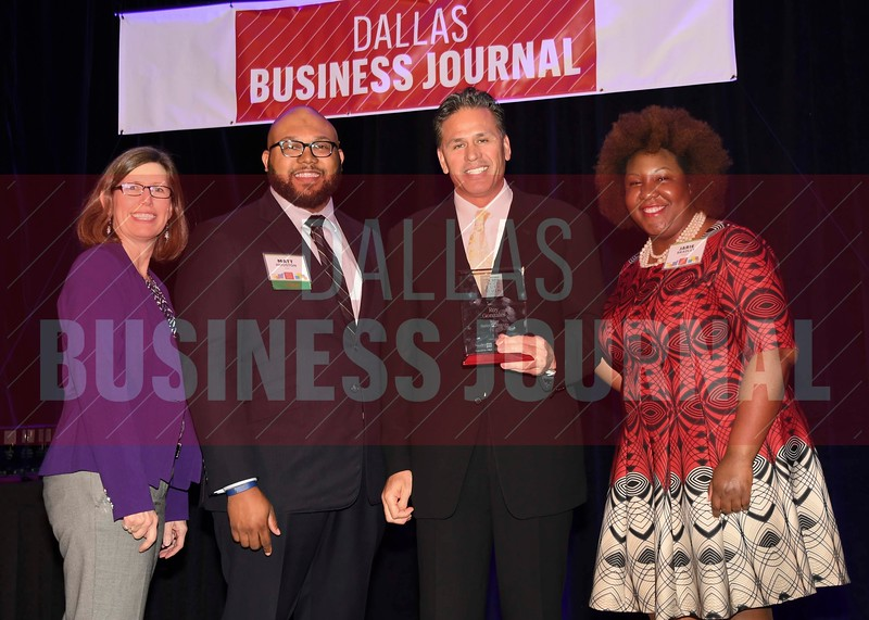 Roy Gonzales, CEO, Royse Building Services (center) receives his Minority Business leader Award, from Dr. Suzanne Carter and Matt Houston (from left) and Jarie Bradley (right) with sponsor TCU's Neeley School of Business Executive MBA program.