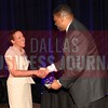 Cheryl McCarver, receives a gift from Kevin Davis with sponsor Neeley School of Business at TCU Executive MBA.