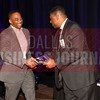 Raymond R. Ferrell, receives a gift from Kevin Davis with sponsor Neeley School of Business at TCU Executive MBA.