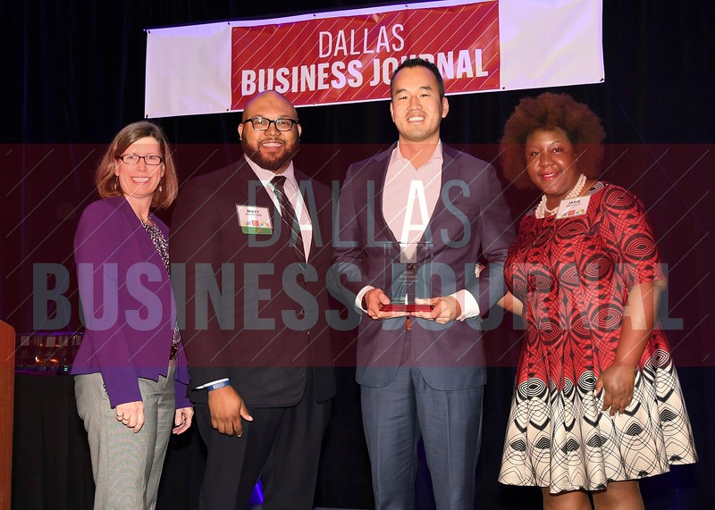 Nate Foreman, President, Foreman Therapy Services (center) receives his Minority Business leader Award, from Dr. Suzanne Carter and Matt Houston (from left) and Jarie Bradley (right) with sponsor TCU's Neeley School of Business Executive MBA program.