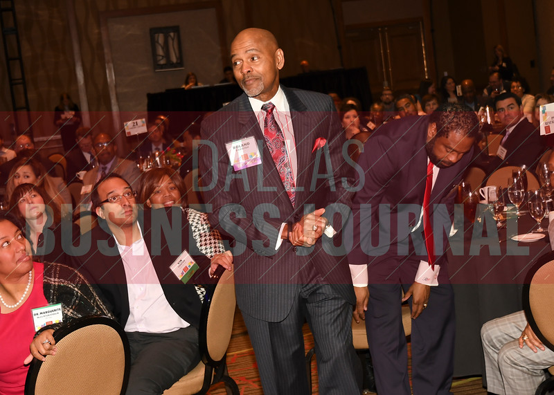 Roland Parrish's makes his way to the stage to accept his Minority Business Leader's Lifetime Achievement Award.