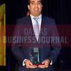 Sunny Sajnani, Principal and director, Metropolitan Capital Advisors with his Minority Business Leader Award.