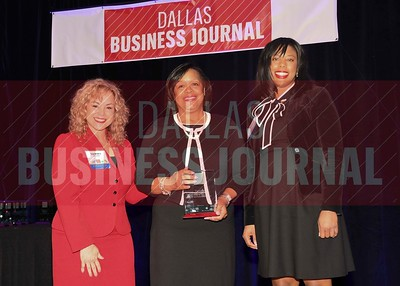 , (center) receives his Minority Business leader Award, from Tammy Wood, (left), and Sonja McGill, (right) partners with sponsor Bell Nunnally.