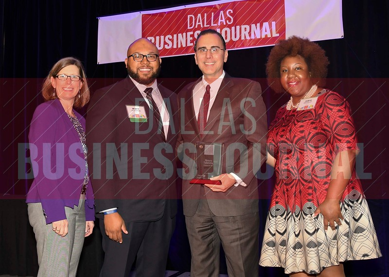 Henry Talavera, Shareholder, Polsinelli PC (center) receives his Minority Business leader Award, from Dr. Suzanne Carter and Matt Houston (from left) and Jarie Bradley (right) with sponsor TCU's Neeley School of Business Executive MBA program.