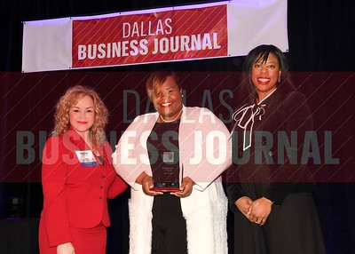 Kimberly O'Neil, Founder and managing director, Cause Studio (center) receives her Minority Business leader Award, from Tammy Wood, (left), and Sonja McGill, (right) partners with sponsor Bell Nunnally.