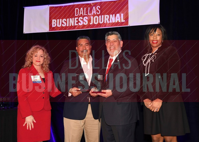 Buddy Puente and Vince E. Puente, Sr. Southwest Office Systems, Inc., (center) receive their Minority Business leader Award, from Tammy Wood, (left), and Sonja McGill, (right) partners with sponsor Bell Nunnally.