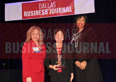 Vicky Teherani, President, More2 Wealth Management, (center) receives her Minority Business leader Award, from Tammy Wood, (left), and Sonja McGill, (right) partners with sponsor Bell Nunnally.