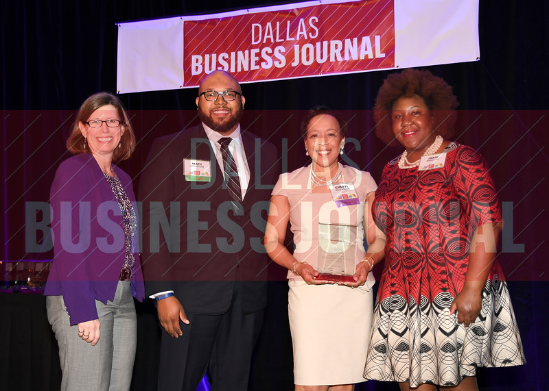 Cheryl McCarver, Vice president and executive director, Health and Wellness Alliance for Children, Children's Health (center) receives her Minority Business leader Award, from Dr. Suzanne Carter and Matt Houston (from left) and Jarie Bradley (right) with sponsor TCU's Neeley School of Business Executive MBA program.