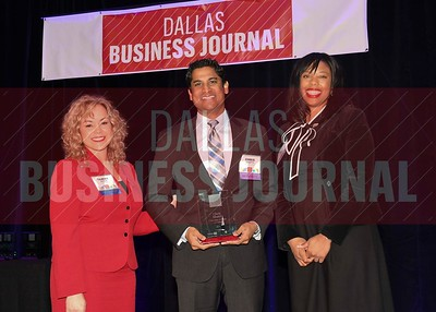 Chris Bhatti, Assistant dean The University of Texas at Dallas, (center) receives his Minority Business leader Award, from Tammy Wood, (left), and Sonja McGill, (right) partners with sponsor Bell Nunnally.
